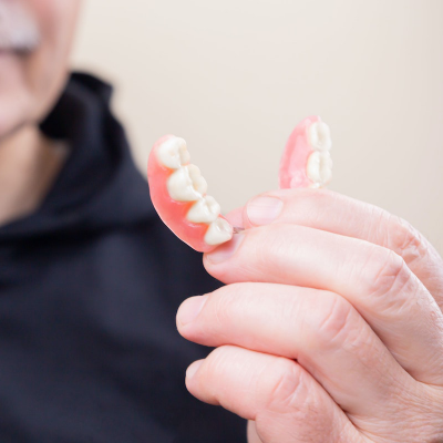 Looking into implant-supported dentures? Common FAQS about the process answered